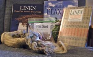 Books, seeds, flax strick, and yarn.